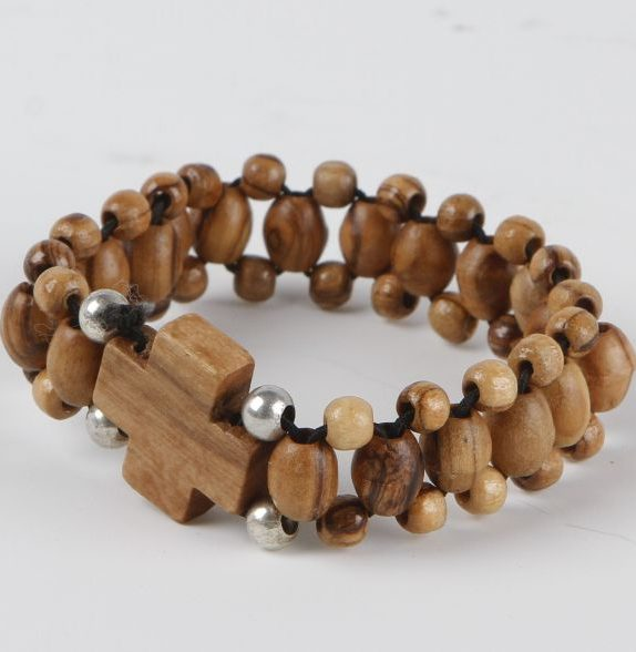 Elastic olive wood rosary bracelet with cross and silver bead
